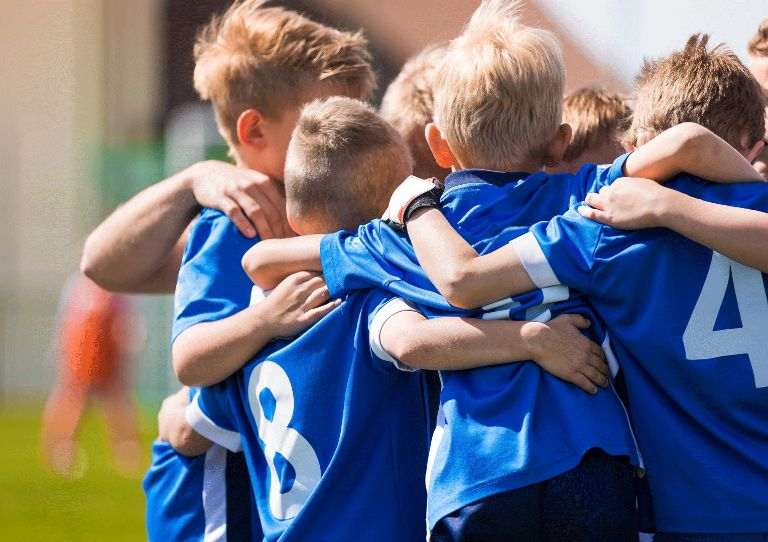 Kid Soccer Team Hug